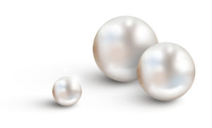 Pearl background on white - Three different sizes of white pearls